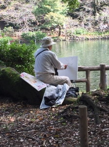 An artist focusing on his work. Photo by Trang Nguyen.